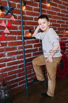 Boy in a loft studio