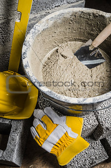 Tools of the mason and  bucket with a solution