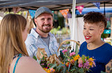Couple with Flower Seller at Famers Market