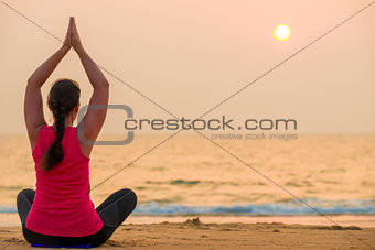 beautiful sunset over the sea and athletic girl