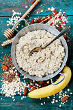 Bowl of oatmeal porridge with healthy ingredients