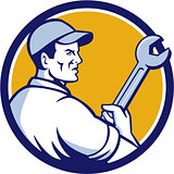 Mechanic Holding Monkey Wrench Circle Retro