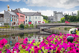 flower lined riverside view of kilkenny