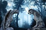 Ancient eagle and lion statues in misty forest