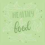 Healthy food vector poster design with vector hand lettering and abstract leaves and dots background