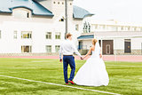 European Football Championship concept. Wedding couple on the football stadium.