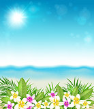 Tropical flowers and beach.