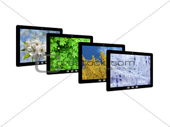 four tablet computers with images of seasons