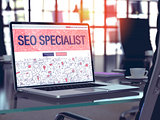 Laptop Screen with SEO Specialist Concept.