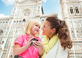 Mother and child with digital camera near Cattedrale in Florence