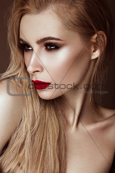 Beautiful sexy blonde girl with sensual lips, fashion hair, black art nails. Beauty face.