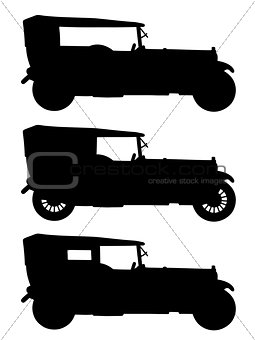Black silhouettes of vintage cars