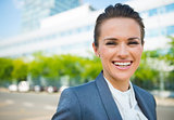 Portrait of smiling business woman in modern office district