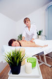 Elegant hands make a relaxing massage in spa salon young girl