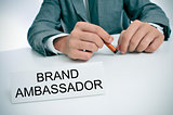 man and name plate with the text brand ambassador