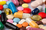 Scattered colorful medical pills and drugs