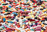 Scattered various colorful medical pills and drugs