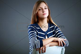 Beautiful young woman in studio looking at camera