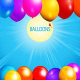 Balloons over sunny sky background