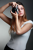 Photographer girl shooting images. Attractive blonde woman takin