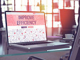 Improve Efficiency on Laptop in Modern Workplace Background.