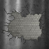 Exposed brick wall with cracked metal
