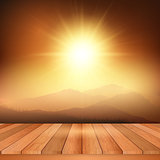 Wooden table looking out to sunny landscape