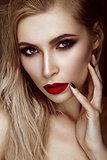 Beautiful sexy blonde girl with sensual lips, fashion hair, black art nails. Beauty face.