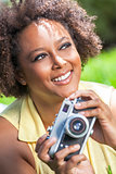 Mixed Race African American Girl Outside With Camera