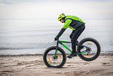 Young man on fat bike