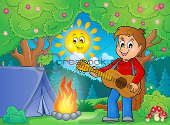 Boy guitar player in campsite theme 1