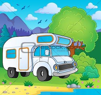 Camping van on lake shore