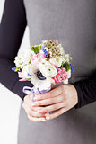 Holding a beautifull spring bouquet