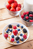 Healthy and nutritious yogurt with cereal and fresh raw berries