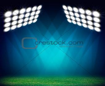 Green soccer field, illuminated spotlights