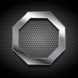 Metal octagon logo on perforated background