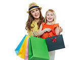Portrait of smiling mother and daughter with shopping bags