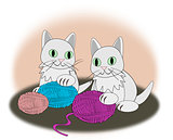 Kittens with balls of yarn