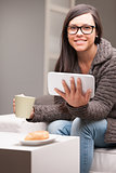 woman with glasses tablet and a mug