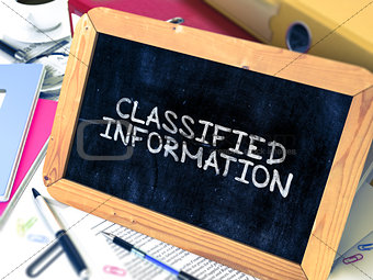 Classified Information - Chalkboard with Hand Drawn Text.
