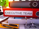Executive Team on Red Office Folder. Toned Image.