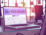 Laptop Screen with SEO Web Design Concept.