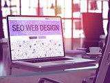 Laptop Screen with SEO Web Design Concept.
