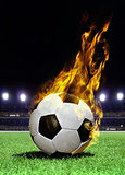 fiery soccer ball on stadium