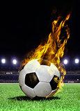 fiery soccer ball on stadium