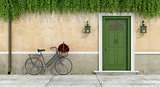 Country house with old door and bicycle