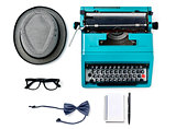 hat, typewriter, eyeglasses, bow tie, notebook and pen
