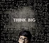 Think Big. Half Face Genius Boy Thinking Wearing Glasses Chalkbo