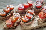 Toasts with tahini and mint sauce and cherry tomatoes