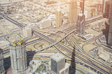 Highway road intersection in Dubai, sunny day, tilt-shift shooting